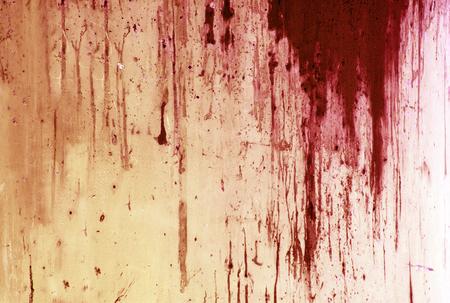 ハロウィンの背景。金属壁の背景に血液