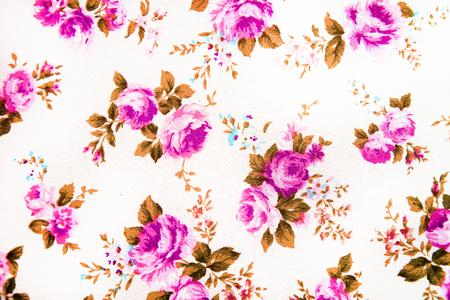 花柄生地、花飾りの背景として役に立つとカラフルなレトロなタペストリーの織物のパターンのフラグメント