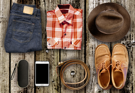 Overhead view Men casual outfits on wood background