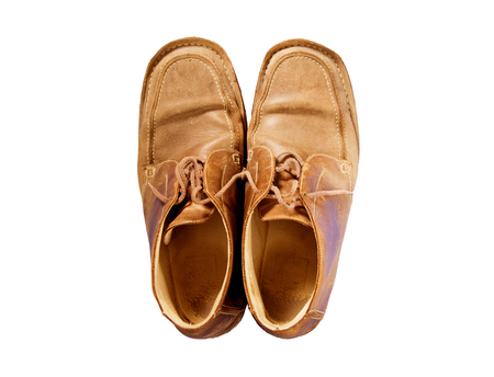 male brown old leather shoes isolated on a white, top view