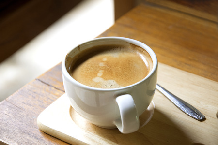 coffee in white cup on wooden background Stock Photo