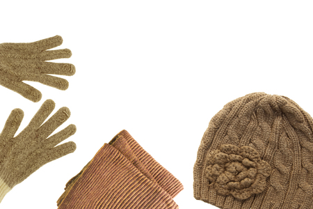 knitting wool and winter hat and gloves set on white background. Winter clothes. Winter accessories.