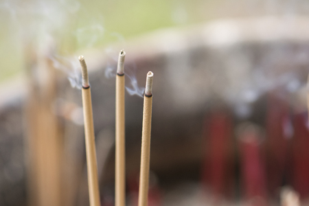 Burning incense sticks in temple. There is a lot of smoke. Standard-Bild