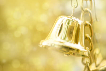 gold bells against defocused background