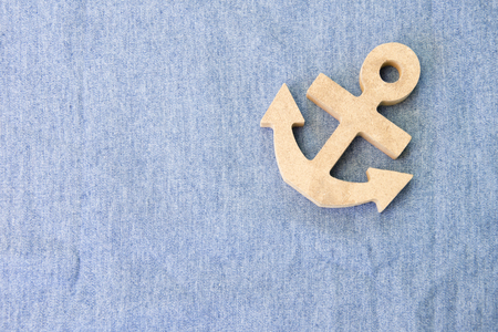 A wood anchor on fabric for background