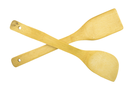 Wooden spatula and ladle on white background.