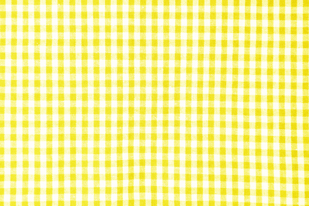 Yellow table cloth texture background, tablecloth top view