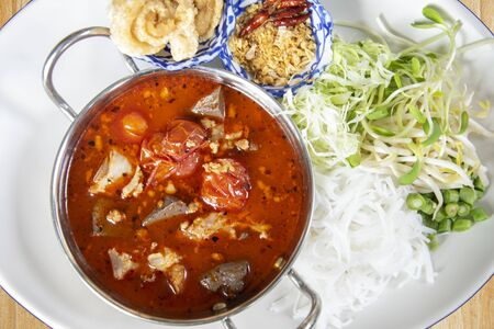 rice noodles with spicy pork sauce or Khanom Jin Nam Ngiao, northen Thai food.