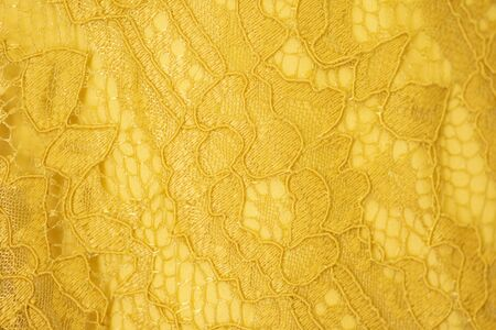 Lace fabric background, yellow lace fabric Stock Photo
