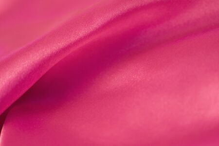 Smooth elegant pink silk or satin texture can use as background Archivio Fotografico - 128510251