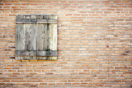 old wooden window on brown brick wall background Archivio Fotografico - 128510685