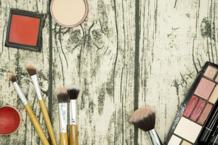 Make up and cosmetic beauty products on table wood background. Archivio Fotografico - 128510688