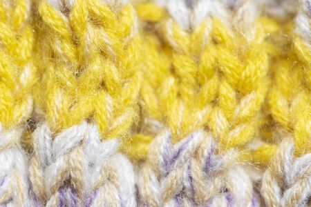 Background of the wool yarn. Woolen fabric texture closeup. Textile texture background. Detailed warm yarn background. Archivio Fotografico - 128511050