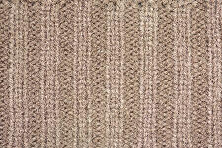 Hintergrund des Wollgarns. Wollstoff Textur Nahaufnahme. Textile Textur Hintergrund. Ausführlicher warmer Garnhintergrund.