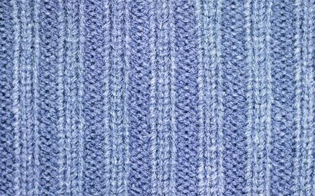 Background of the wool yarn. Woollen fabric texture closeup. Textile texture background. Detailed warm yarn background.