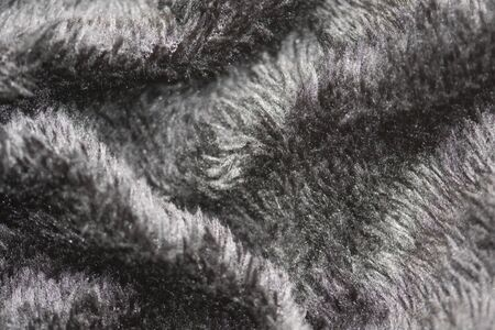 Texture of fur of wild animals background. Line wool floor with black light.
