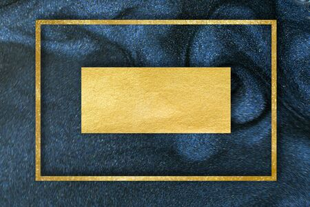 Golden glitter dust on dark blue background.