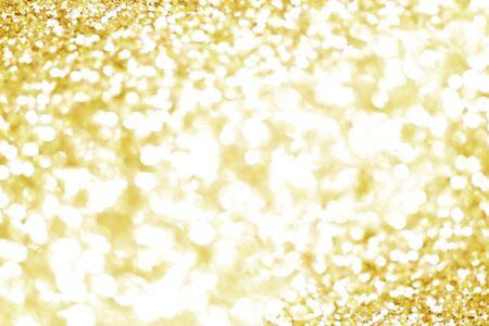 Gold bokeh texture. Festive glitter background with defocused lights Stockfoto