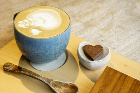 Hot Cappuccino In Cup On Wooden Table With Copy-space. The Latte Art On coffee background. 免版税图像