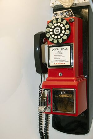 vintage coin telephone. vintage metal Public telephone with a coin box. 免版税图像