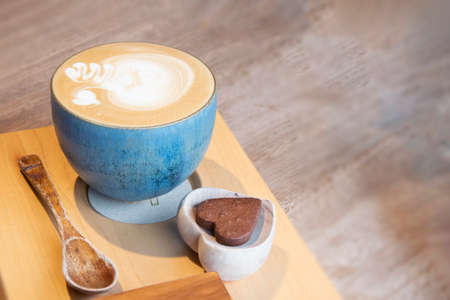 Hot Cappuccino In Cup On Wooden Table With Copy-space. The Latte Art On coffee background. Foto de archivo