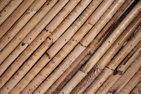 Close up decorative old bamboo wood of fence wall background Foto de archivo