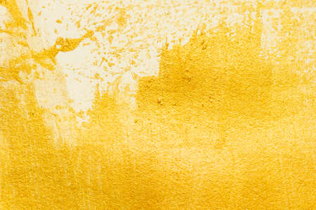 Gold acrylic paint texture on white paper background
