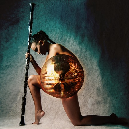 spear: Fashion studio shot of beautiful woman in armour on background Stock Photo