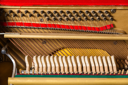 classical mechanics: detail of a piano string Stock Photo