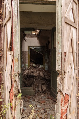 doorways: Shot of an old abandoned building through the doorways