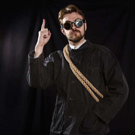 boilersuit: workman pointing a great idea . black background Stock Photo