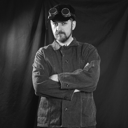 boilersuit: beard welder with arms crossed on his chest Stock Photo
