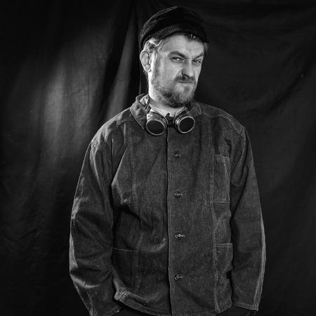 boilersuit: dissatisfied welder in black boilersuit