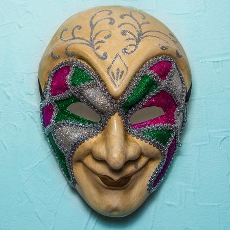 joker: Sinister Joker mask on blue wall