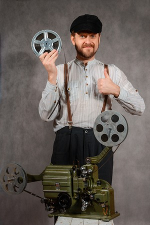 cinematographer: Cameraman with with a film projection