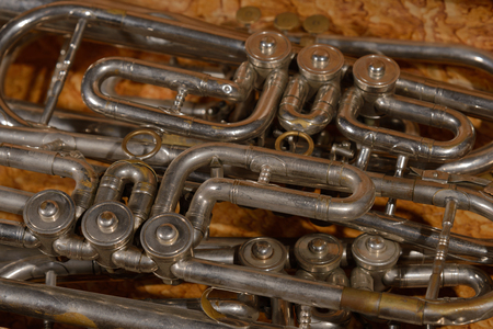 flugelhorn: Fragment four  old broken trumpet  in box.