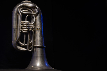 silver tuba isolated on black background