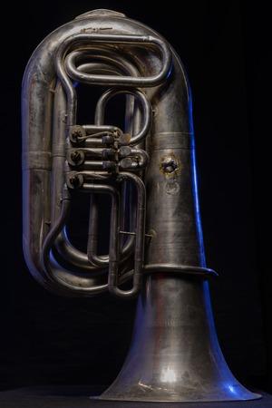 tuba: silver tuba isolated on black background