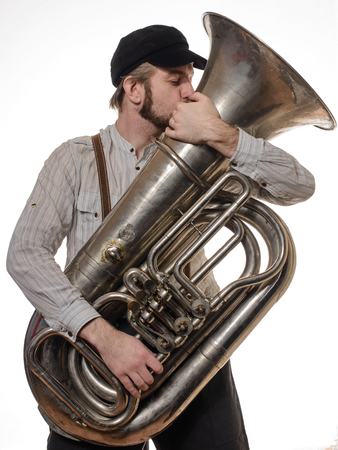 beard loving man with suspenders and cap tube kisses