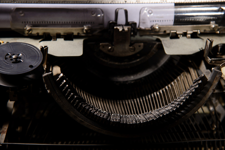 styled: Retro styled image of an old typewriter on a table
