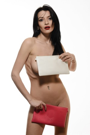 nude blonde girl: Fashion studio photo of elegant nude woman with two clutch Stock Photo