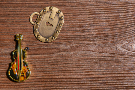 resonator: Keychain bass Lighter and key lock on a wooden background