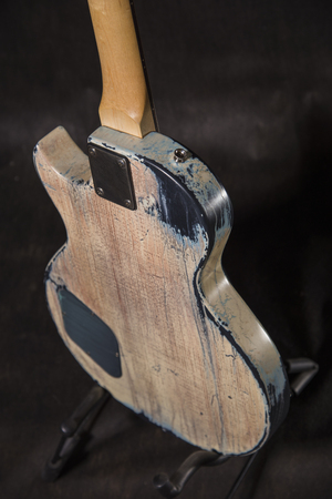 Aged guitar back on black background Stock Photo