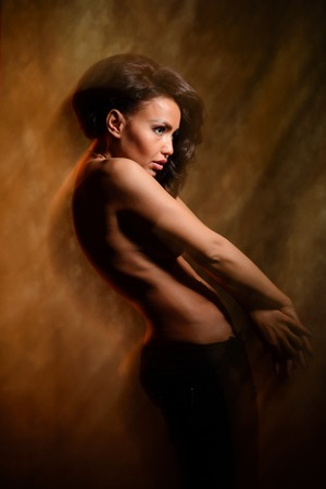 sexy topless woman: Fashion art photo of a beautiful girl in mixed light in studio Stock Photo