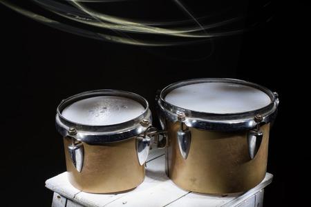 bongos: Latin percussion, old broken bongos. light brush