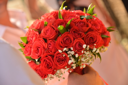 romance rose: wedding bouquet of red roses and leaves Stock Photo