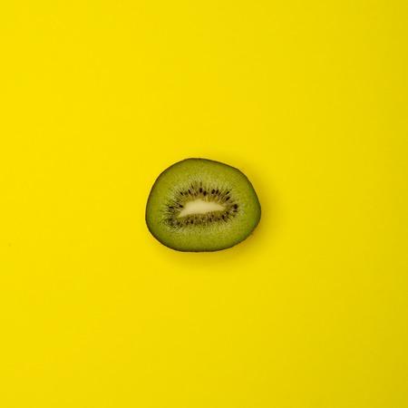 kiwifruit: Cut kiwifruit on yellow background