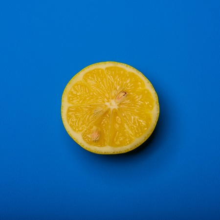 citric: A Slice of lemon shot on a blue background