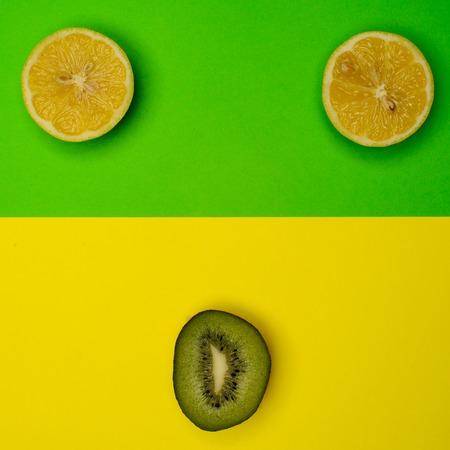 freshest: Smiley from the kiwi and lemon on a colored background. Fresh kiwis and lemon fruit, interesting fruit composition