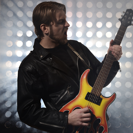 rock guitarist: rock guitarist playing electric guitar in fog
